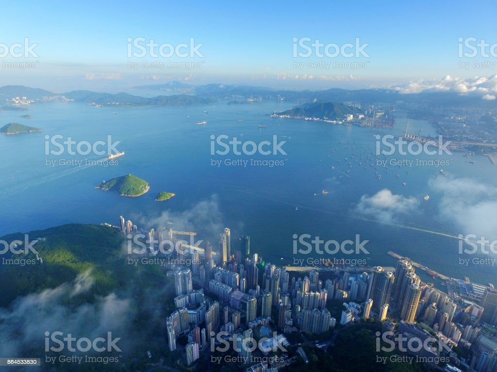 Aerial view of Hong Kong city and Victoria harbour at Morning stock photo