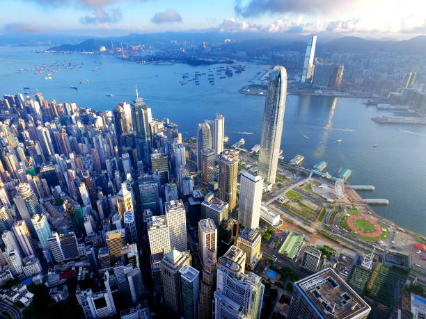 aerial view of hong kong city and victoria harbour - hong kong foto e immagini stock