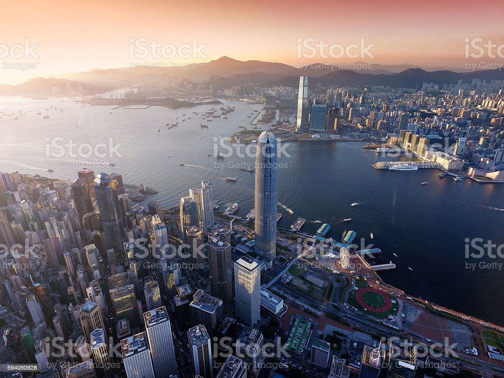 Aerial view of Hong Kong city, Victoria harbour in sunset stock photo