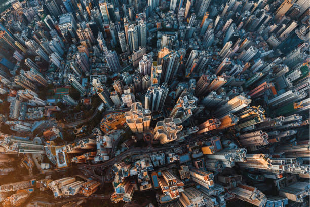 Aerial view of Hong Kong Downtown. Financial district and business centers in smart urban city in Asia. Top view of skyscraper and high-rise buildings at sunset. stock photo
