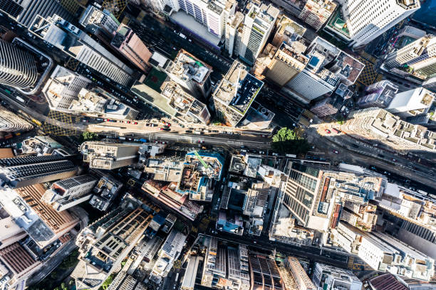 aerial view of hong kong downtown. financial district and business centers in smart city in asia. top view of skyscraper and high-rise buildings. - smart city imagens e fotografias de stock
