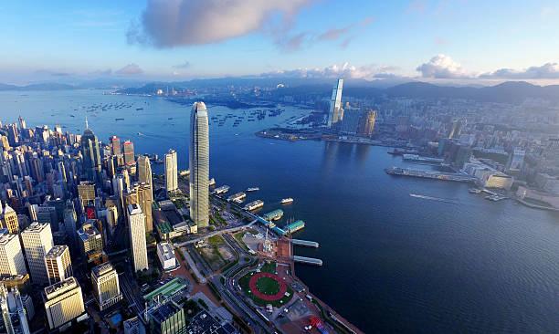 aerial view of hong kong, victoria harbour in sunrise - hong kong foto e immagini stock