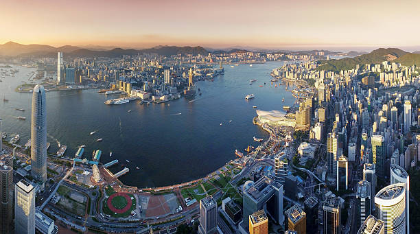 aerial view of hong kong, victoria harbour in sunset - kowloon stock-fotos und bilder