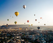 Aerial view of hot air balloons flying over Cappadocia at sunrise,Turkey