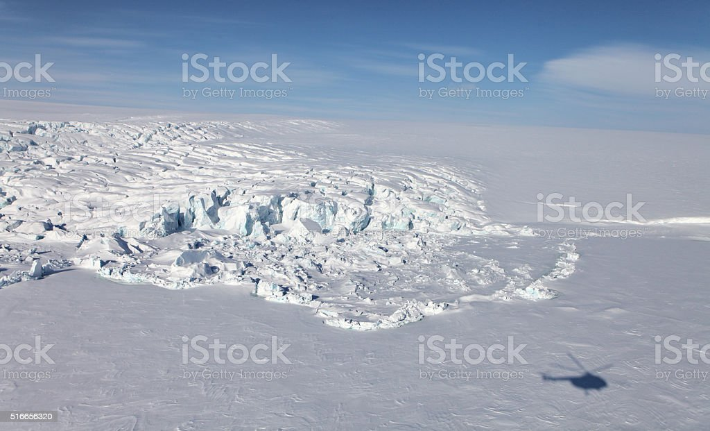 Aerial view of iceberg in frozen and helicopter shadow stock photo
