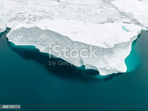 istock Aerial view of icebergs on Arctic Ocean in Greenland 899100774