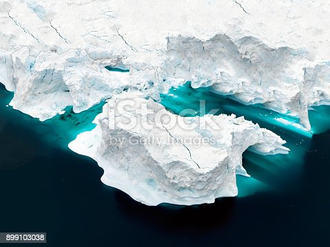 istock Aerial view of icebergs on Arctic Ocean in Greenland 899103038