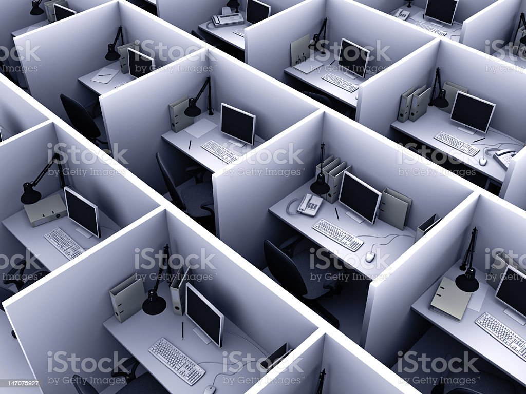 Aerial view of identical cubicles with desktop computers stock photo