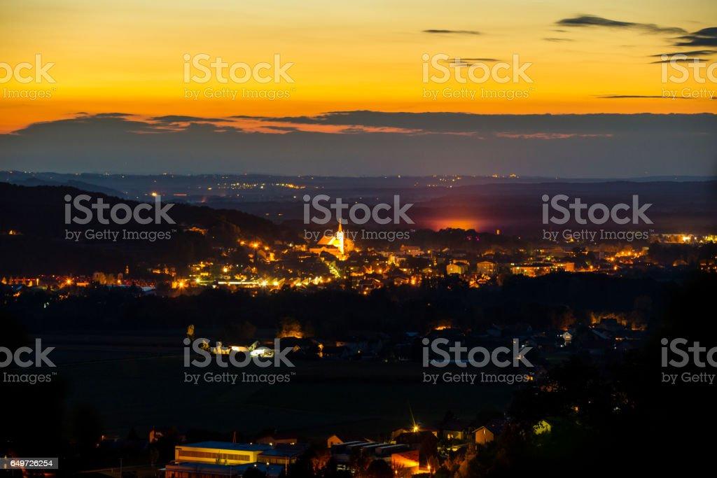 Aerial view of illuminated city with vineyard stock photo