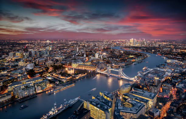 Aerial view of illuminated London, UK, during evening time stock photo