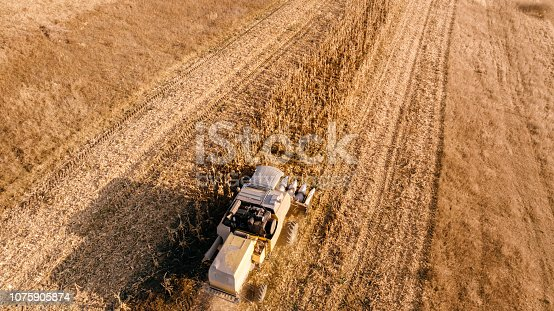 1072634078 istock photo Aerial view of industrial agriculture machinery 1075905874