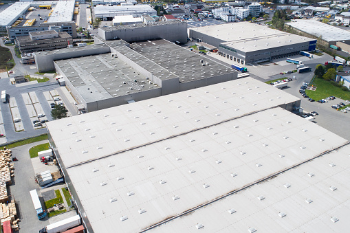 Aerial view of industrial district, large factory and distribution buildings