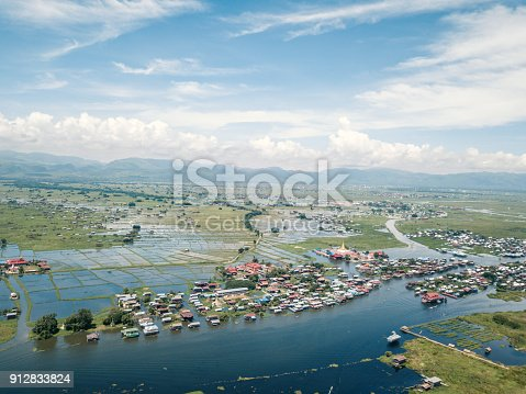 Aerial view of beautiful Inle lake and the Phaung Daw Oo Pagoda, a religious site in the village of Ywama on the west side of the Inle Lake in the Shan state of central Myanmar