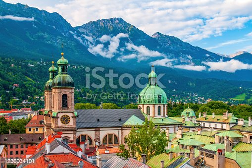 Aerial view of Cathedral of St. Jacob (Dom) and roofs of Imperial Palace (Hofburg) in old city of Innsbruck, Alps mountains in background taken from town hall tower, Tirol, Austria