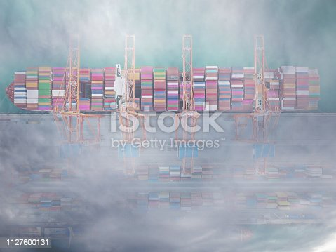 Aerial view of international port with crane loading containers under clouds.
