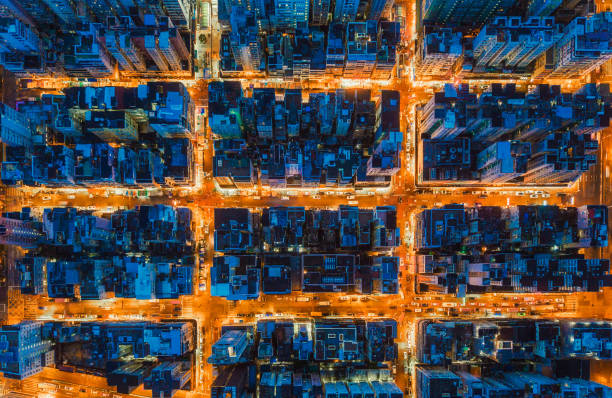 aerial view of intersection in hong kong downtown. financial district and business centers in smart city, technology concept. top view of buildings at night. - smart city imagens e fotografias de stock