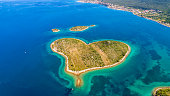 Aerial view of island and seashore in summer