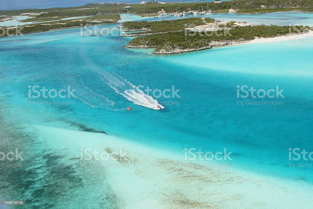 Aerial view of islands,coral reef Bahamas and jet skiers stock photo