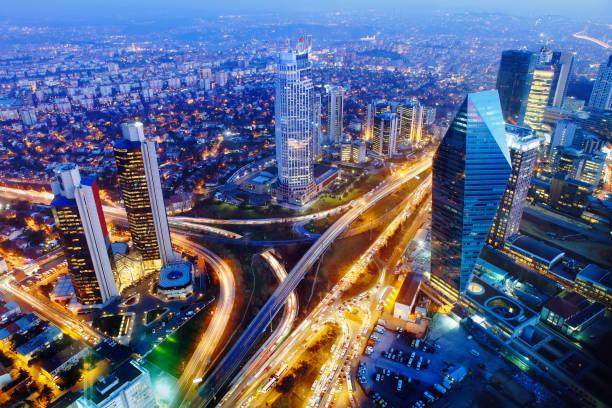 aerial view of istanbul lit up at night - стамбул стоковые фото и изображения