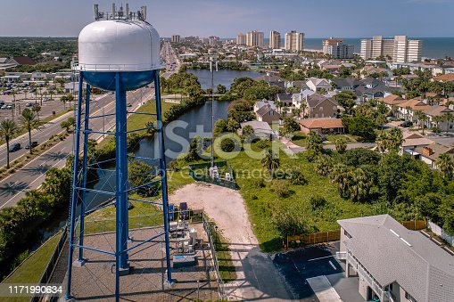 Northward facing aerial view of Jacksonville Beach, Florida featuring State Road A1A, water tower and row of beachfront condominiums.