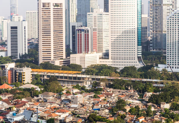 aerial view of jakarta financial district, indonesia capital city in asia - imbalance stock photos and pictures