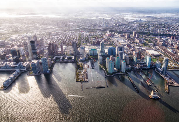 aerial view of Jersey City in front of Hudson river stock photo