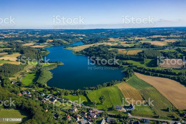 Photo of Aerial view of Kashubian Landscape Park. Kaszuby. Poland. Photo made by drone from above. Bird eye view.