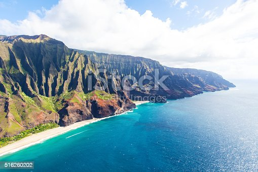 stunning aerial view of na pali coast at kauai island, hawaii from helicopter