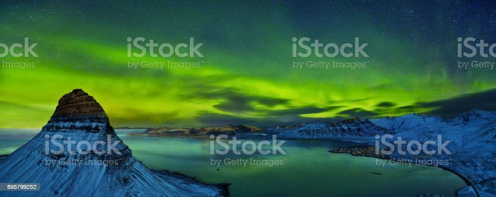 Aerial view of Kirkjufell mountain with beautiful aurora borealis in winter, Iceland. stock photo