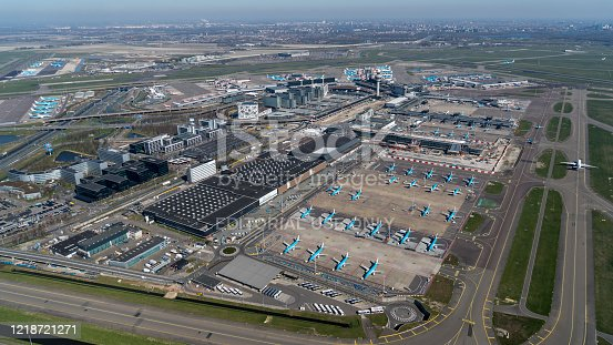 Amsterdam, Holland, March 25, 2020. These Embraer Jet airplanes are grounded due to government regulations. These blue aircrafts are parked at Schiphol A gate.