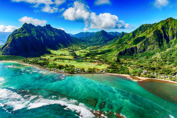 Aerial View of Kualoa area of Oahu Hawaii The beautiful and unique landscape of coastal Oahu, Hawaii and the Kualoa Ranch where Jurassic Park was filmed as shot from an altitude of about 1000 feet over the Pacific Ocean. oceania stock pictures, royalty-free photos & images