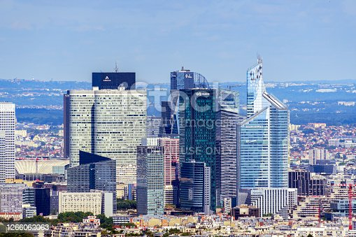 Paris, France - July 09 2020: Aerial view of La Defense business district skyscrapers. Day shot from Tour Montparnasse observation desk.
