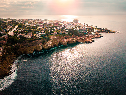 Aerial view of sunny La Jolla village in San Diego California with houses on the cliffs of Pacific ocean