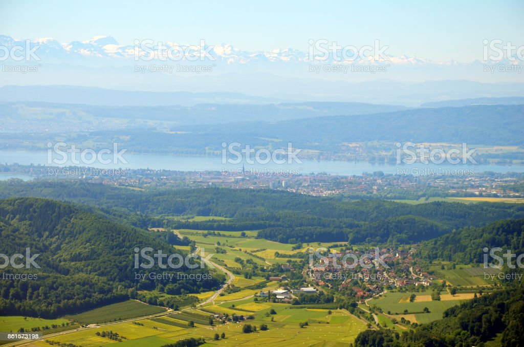 Aerial view of Lake Constance with Alps in background on a sunny summer day stock photo