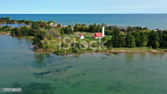Aerial view of the Tawas Point lighthouse on Lake Huron in Tawas Point State Park.
