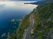 An aerial view of Lake Tahoe and the road wrapping around it.