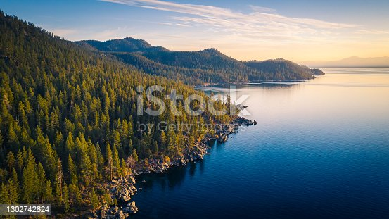istock Aerial View of Lake Tahoe Shoreline with Mountains and Turquoise Blue Waters 1302742624