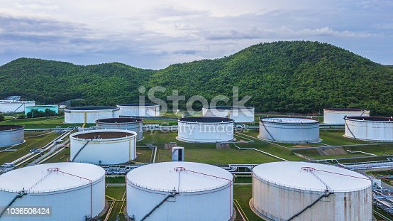 Aerial view of large fuel storage tanks at oil refinery industrial zone, White oil storage tanks farm.