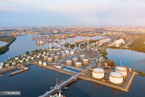 Aerial view of large fuel storage tanks at oil refinery industrial zone in the cargo seaport