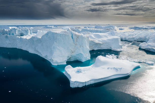 Aerial view of large glacier and iceberg stock photo