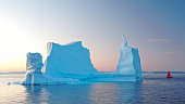 istock Aerial view of large glacier and iceberg 1214631596