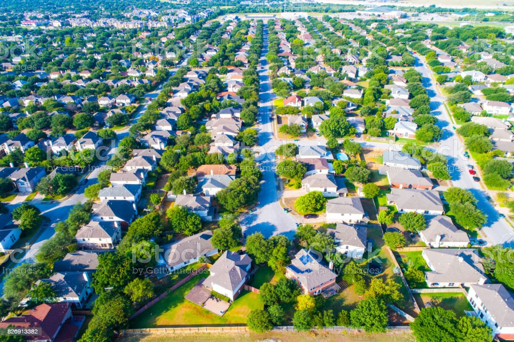 Aerial View of Large Suburb Entire View repeated homes and perfect rows of Houses and rooftops looking down on Neighborhood in North Austin near Wells Branch stock photo