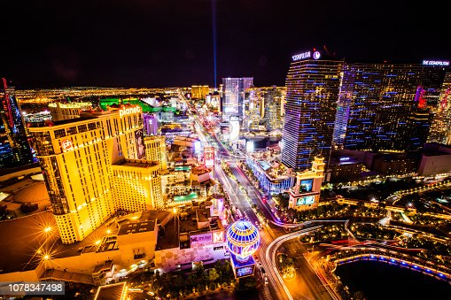 June 19, 2016 - World famous Las Vegas Strip at night with a view of Planet Hollywood Hotel, Cosmopolitan Hotel and streets