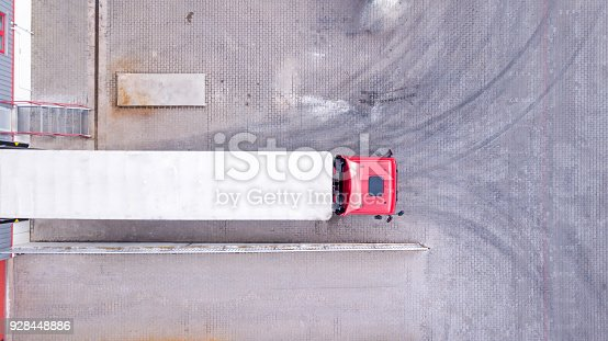 istock Aerial View of Loading Warehouse with Semi Truck. Aerial 928448886