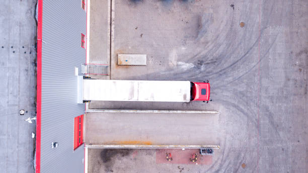 aerial view of loading warehouse with semi truck. aerial - musica industrial foto e immagini stock