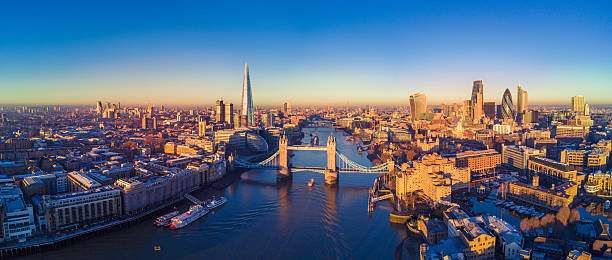 Aerial view of London and the River Thames Aerial panoramic cityscape view of London and the River Thames, England, United Kingdom london england stock pictures, royalty-free photos & images