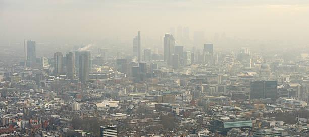 aerial view of london in the fog - smog stockfoto's en -beelden