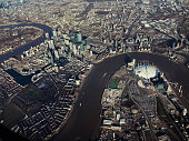 A wide, high angle view of London from above including the Thames River.