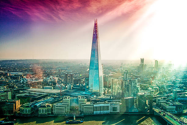 aerial view of london with the shard skyscraper at sunset - shard london bridge stockfoto's en -beelden