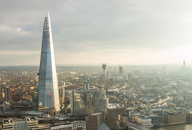 aerial view of london with the shard skyscraper - shard london bridge stockfoto's en -beelden